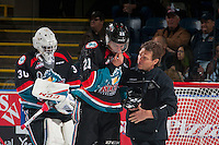 KELOWNA, CANADA - OCTOBER 26: Kelowna Rockets' athletic therapist, Scott Hoyer walks on the ice with Devante Stephens #21 as he heads to the bench after a check by the Victoria Royals on October 26, 2016 at Prospera Place in Kelowna, British Columbia, Canada.  (Photo by Marissa Baecker/Shoot the Breeze)  *** Local Caption ***