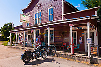 Harley-Davidson motorcycle parked in front of the Aladdin General Store, Aladdin (population 15), Wyoming USA