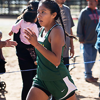 Holly Tsosie from Thoreau High School comes in second place for the girls varsity cross country at the Curtis Williams Invitational, Saturday Oct. 6, 2018 at Red Rock Park in Church Rock.