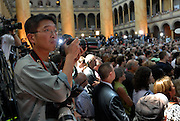 DISTRICT OF COLUMBIA - June 7, 2008:  Photojournalist Alex Wong of Getty Images documents U.S. Senator Hillary Clinton as she ends her presidential bid for the White House in addition to her endorsement of presumptive democratic nominee for president, Sen. Barack Obama on Saturday at the National Building Museum in Washington, DC.