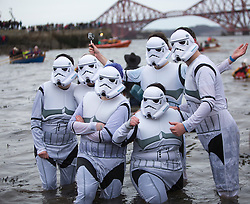 The Stoats Loony Dook at South Queensferry, the annual new year dip in the freezing River Forth in the shadow of the world-famous Forth Bridges.