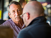 23 SEPTEMBER 2019 - DES MOINES, IOWA: MARK SANFORD, the former Republican Governor of South Carolina and six term Congressman from South Carolina, talks to people at Zombie Burger, a Des Moines restaurant, Monday. Sanford is challenging incumbent President Donald Trump for the Republican nomination for the US presidency. Iowa hosts the first event of the presidential selection cycle. The Iowa Caucuses are scheduled for February 3, 2020.        PHOTO BY JACK KURTZ