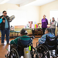 Miyamura High School's Native American Club visits McKinley Manor, Friday March 22. Ryedale Largo sings round dance songs, song and dance songs and Mescalero Apache Songs while Kyia Dawes, the Miyamura High School Native American Princess holds the microphone for him.