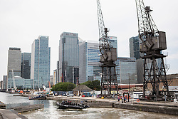 © Licensed to London News Pictures. 30/06/2015. London, UK. Armed officers travelling by boat near Wood Wharf in the Canary Wharf area. A joint exercise called 'Exercise Strong Tower' between the three emergency services continued today.  Photo credit : James Gourley/LNP