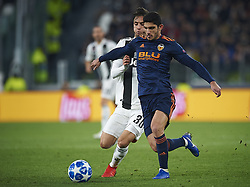November 27, 2018 - Turin, Italy - Rodrigo Betancur of Juventus (L) disputes the ball with Gonzalo Guedes of Valencia during the UEFA Champions League match between Juventus and Valencia CF at Allianz Juventus Stadium  in Turin, Italy on November 27, 2018  (Credit Image: © Jose Breton/NurPhoto via ZUMA Press)