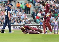 Cricket - 2017 West Indies Tour of England - Fourth One Day International (ODI): England vs. West Indies<br /> <br /> Evin Lewis of West Indies falls down, injured and is forced to retire as Captain Jason Holder comes to check on him at The Oval.<br /> <br /> COLORSPORT/ANDREW COWIE