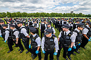 """Police arrest a man after surrounding him with a large cordon - The picnic moves and, once resettled, the police start to break up large groups - A so called 'Mass' Gathering takes place in Hyde Park as a small group of protestors say no to the """"coronavirus bill"""" and no to the """"unlawful lockdown"""", as they fear for their freedom during the coronavirus pandemic. The protest was outnumbered by police and journalists and attracted people against vaccination, 5G, Bill Gates, paedophiles, tracking and many other things. The 'lockdown' continues for the Coronavirus (Covid 19) outbreak in London."""