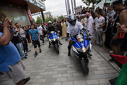 "© Licensed to London News Pictures . 12/07/2014 . Manchester , UK . A "" Free Palestine "" motorcycle convoy at Media City makes it way through crowds . Thousands of people outside the BBC at Media City in Salford , Greater Manchester , this afternoon (Saturday 12th July 2014) , protesting Israeli actions in Gaza and the Corporation's coverage of the Israeli Palestinian conflict . A convey branded "" Drive for Justice "" travelled from out of the city from Bradford , Blackburn and other regions , to form the protest . Photo credit : Joel Goodman/LNP"