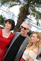 Emily Hampshire, David Cronenberg, Sarah Gadon  at Cosmopolis photocall at the 65th Cannes Film Festival France. Cosmopolis is directed by David Cronenberg and based on the book by writer Don Dellilo.  Friday 25th May 2012 in Cannes Film Festival, France.