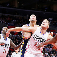 25 November 2015: Utah Jazz center Rudy Gobert (27) vies for the rebound with Los Angeles Clippers forward Blake Griffin (32), Los Angeles Clippers guard Jamal Crawford (11) and Los Angeles Clippers center DeAndre Jordan (6) during the Utah Jazz 102-91 victory over the Los Angeles Clippers, at the Staples Center, Los Angeles, California, USA.