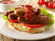 Traditional chipolatta pork sausages with tomato ketchup sandwich