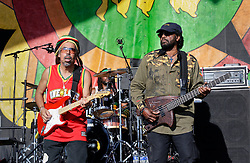 """30 April 2015. New Orleans, Louisiana.<br /> The New Orleans Jazz and Heritage Festival. <br /> Stephen 'Cat' Coore (l) and Richie """"Bassie"""" Daley of legendary Reggae band Third World playing the Congo Square stage.<br /> Photo; Charlie Varley/varleypix.com"""