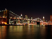 Panoramic view of the Brooklyn Bridge and downtown Manhattan by night.