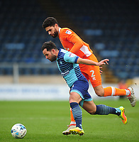 Wycombe Wanderers' Sam Wood under pressure from Blackpool's Kelvin Mellor<br /> <br /> Photographer Kevin Barnes/CameraSport<br /> <br /> The EFL Sky Bet League Two - Wycombe Wanderers v Blackpool - Saturday 11th March 2017 - Adams Park - Wycombe<br /> <br /> World Copyright © 2017 CameraSport. All rights reserved. 43 Linden Ave. Countesthorpe. Leicester. England. LE8 5PG - Tel: +44 (0) 116 277 4147 - admin@camerasport.com - www.camerasport.com