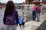 """Visitors and tourists photographing at """"The Temple of Heaven"""" which is a complex of Taoist buildings situated in the southeastern part of central Beijing. Beijing is the capital of the People's Republic of China and one of the most populous cities in the world with a population of 19,612,368 as of 2010."""