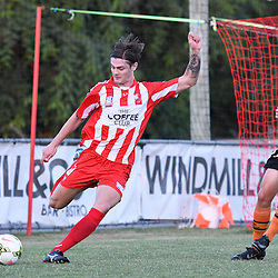 BRISBANE, AUSTRALIA - FEBRUARY 25: Matty Richardson of Olympic FC kicks the ball during the NPL Queensland Senior Men's Round 1 match between Olympic FC and Brisbane Roar Youth at Goodwin Park on February 25, 2017 in Brisbane, Australia. (Photo by Patrick Kearney/Olympic FC)