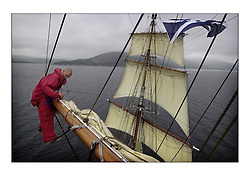 The STA Tall ship The Prince William sailing up the Clyde to her naming ceremony at Yorkhill Quay. .Ole Squires tidies up the yard arm...Pics Marc Turner / PFM