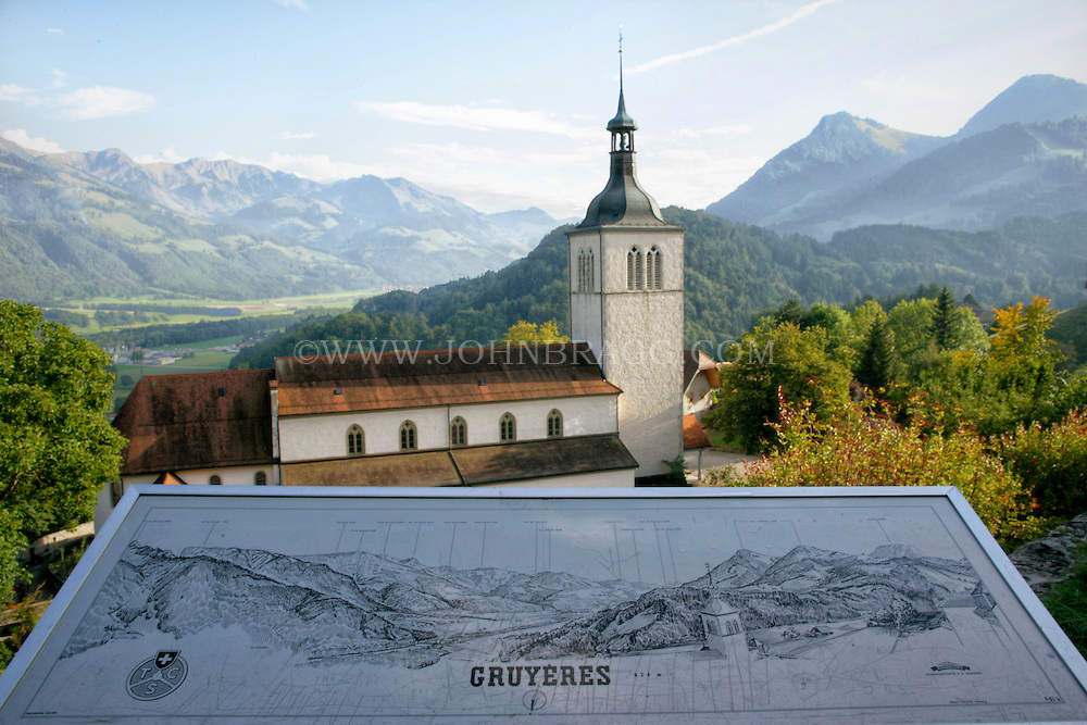 The 13th Century Church of Gruyere with placard and Mount Moleson located in Gruyere, Switzerland