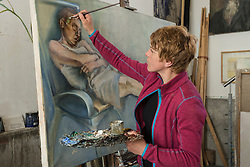 Woman painting at easel, Bavaria, Germany