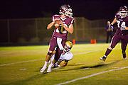 23 SEPTEMBER 2011 - SCOTTSDALE, AZ: Desert Mountain QB Kyle Allen looks for an open receiver 1st qtr at Desert Mountain High School in Scottsdale. Desert Mountain played Notre Dame in Desert Mountain's homecoming high school football game.   PHOTO BY JACK KURTZ