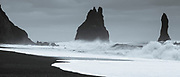 Reynisdrangar basalt sea stacks (troll rocks) and black volcanic sand beach Reynisfjara near Vík i Myrdal, South Iceland