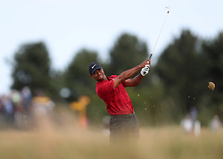 USA's Tiger Woods takes his 2nd shot on the 7th during day four of The Open Championship 2018 at Carnoustie Golf Links, Angus. PRESS ASSOCIATION Photo. Picture date: Sunday July 22, 2018. See PA story GOLF Open. Photo credit should read: David Davies/PA Wire. RESTRICTIONS: Editorial use only. No commercial use. Still image use only. The Open Championship logo and clear link to The Open website (TheOpen.com) to be included on website publishing.