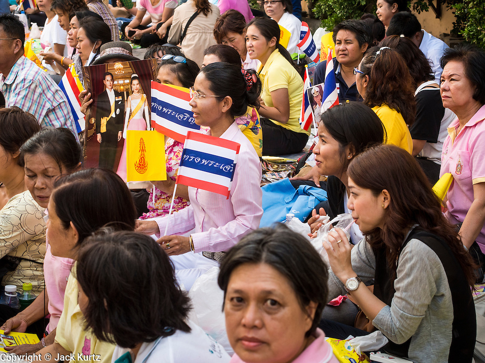 01 AUGUST 2013 - BANGKOK, THAILAND:  The crowd in front of Siriraj Hospital, before Bhumibol Adulyadej, the King of Thailand, left the hospital Thursday. The King, 85, was discharged from Bangkok's Siriraj Hospital, where he has lived since September 2009. He traveled to his residence in the seaside town of Hua Hin, about two hours drive south of Bangkok, with his wife, 80-year-old Queen Sirikit, who has also been treated in the hospital for a year.     PHOTO BY JACK KURTZ