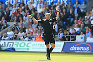 Referee Mike Dean looks on. Barclays Premier league match, Swansea city v Manchester city at the Liberty Stadium in Swansea, South Wales on Sunday 15th May 2016.<br /> pic by Andrew Orchard, Andrew Orchard sports photography.
