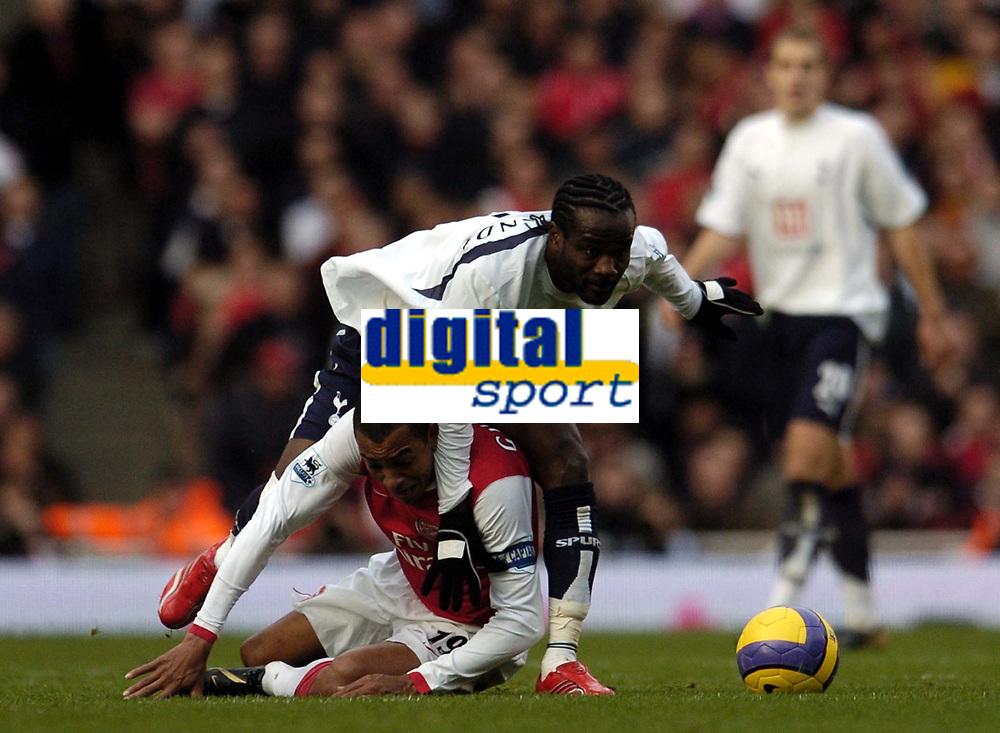 Photo: Olly Greenwood.<br />Arsenal v Tottenham Hotspur. The Barclays Premiership. 02/12/2006. Tottenham's Pascal Chimbonda goes over Arsenal's Gilbreto