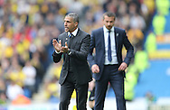 Brighton manager Chris Hughton and Head coach Slavisa Jokanovic during the Sky Bet Championship match between Brighton and Hove Albion and Watford at the American Express Community Stadium, Brighton and Hove, England on 25 April 2015.