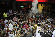 LeBron James throws talcum powder in the air during his pre game ritual with the fans...The Miami Heat lost to the host Cleveland Cavaliers 84-76 at Quicken Loans Arena, April 13, 2008..