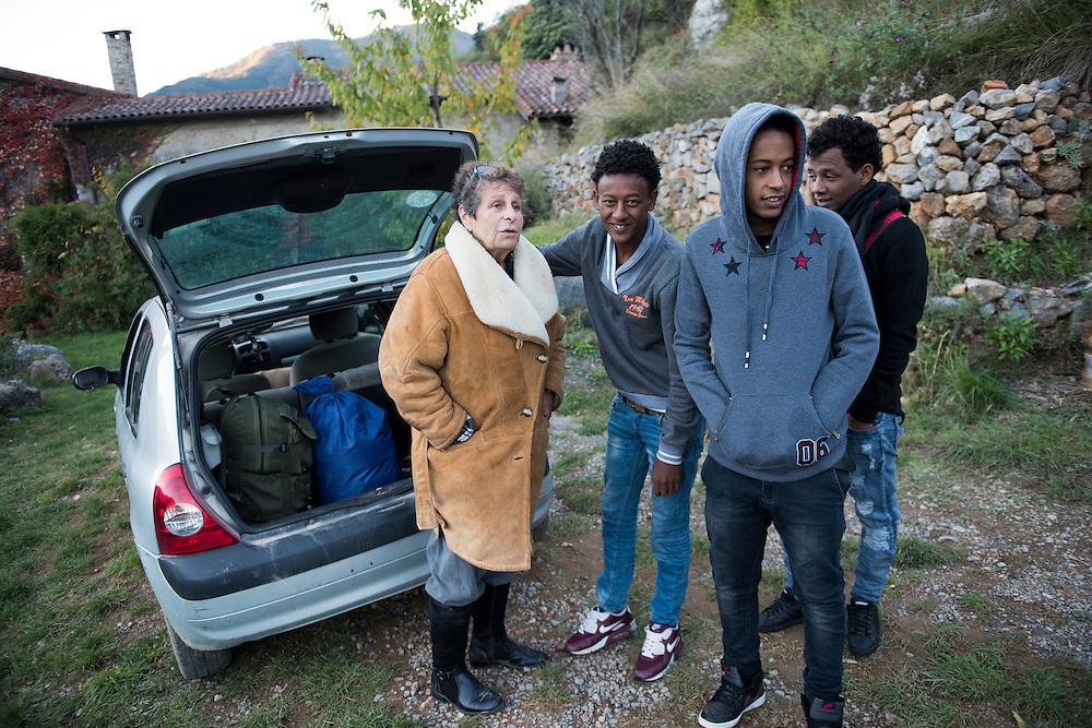 November 8, 2016 - Breil-sur-Roya, France: Françoise Cotta (66) will transport three migrants to Paris - FiIlimon, 17 y, Angossom and Samuel 16 y, all three are Eritreans. Cotta is a lawyer and a member of a network that helps migrants who walked into the valley from Ventimiglia, Italy, with shelter, food and transportation.<br /> <br /> 8 novembre 2016 - Breil-sur-Roya, France: Françoise Cotta (66 ans) transportera trois migrants à Paris - FiIlimon, 17 ans, Angossom et Samuel, 16 ans, tous trois érythréens. Cotta est avocate et membre d'un réseau qui aide les migrants qui sont entrés dans la vallée depuis Ventimiglia, en Italie, avec un hébergement, de la nourriture et des transports.