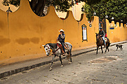 Mexican cowboys ride through the streets of San Miguel de Allende, Mexico.