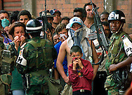 1/29/99 Al Diaz/Herald staff--In downtown Armenia Andres Jiminez waits in line for food along with several hundred people as the Colombian Military Police keep order. Tens of thousands of Colombians are left homeless after Monday's devastating earthquake.