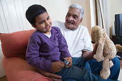 Grandfather holding grandson,