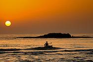 A kayak rower returning to the shore, at Maagan michael