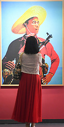 (170730) -- BEIJING, July 30, 2017 (Xinhua) -- A woman stops in front of a work displayed in a photo exhibition marking the 90th anniversary of the People's Liberation Army (PLA) in Beijing, capital of China, July 30, 2017.   (Xinhua/Chen Yehua)(clq) (Photo by Xinhua/Sipa USA)