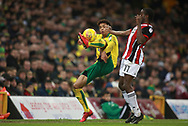 Norwich City's Jamal Lewis and Sheffield United's Clayton Donaldson during the EFL Sky Bet Championship match between Norwich City and Sheffield Utd at Carrow Road, Norwich, England on 20 January 2018. Photo by John Marsh.