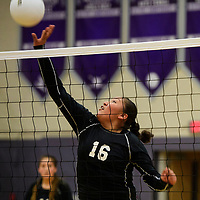 Hailey Long tips the ball over the net for the Gallup Bengals in a match against the Miyamura Patriots Oct. 4, 2018 at Miyamura High School in Gallup.