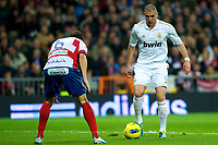 20120107: MADRID, SPAIN - BBVA League: Football macht between Real Madrid C.F vs Granada in Santiago Bernabeu, Madrid, Spain.<br /> In photo: Karim Benzema(R) in action.<br /> PHOTO: CITYFILES