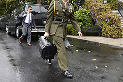 April 25, 2017 - Washington, District of Columbia, U.S. - A military aide carries the ''nuclear football'' on the South Lawn of the White House. The contents of the nuclear football can be used by the President of the United States to authorize a nuclear attack while he is away from fixed command centers, such as the White House Situation Room. It functions as a mobile hub in the strategic defense system of the United States. (Credit Image: © Olivier Douliery/CNP via ZUMA Wire)