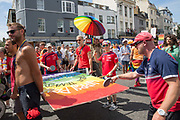 Men playing portable table tennis during the Brighton Pride parade and carnival on the 4th August 2018 in the United Kingdom. Brighton Pride is an annual event held in the city of Brighton and Hove, England, organised by Brighton Pride, a community interest company who promote equality and diversity, and advance education to eliminate discrimination against the lesbian, gay, bisexual and transgender community.