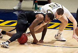 Feb 13, 2021; Berkeley, California, USA; Colorado Buffaloes guard Eli Parquet (24) and California Golden Bears forward Grant Anticevich (15) scramble for a loose ball during the second half of an NCAA basketball game at Haas Pavilion. Mandatory Credit: D. Ross Cameron-USA TODAY Sports