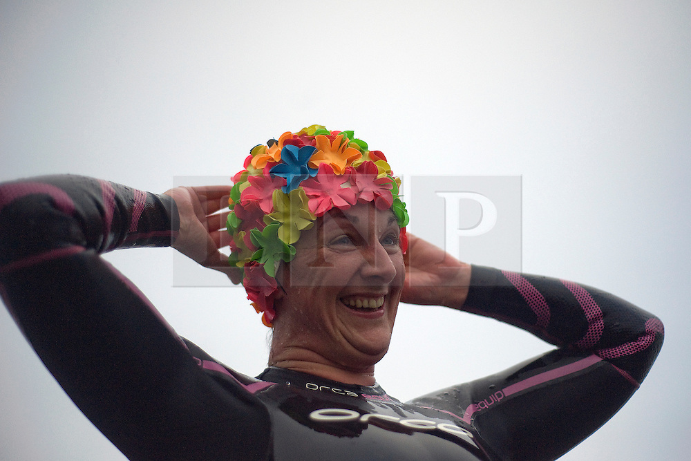 © Licensed to London News Pictures. 26/06/2011. Henley-on-Thames, UK. An exhausted competitor at the finnish. Swimmers take part in the Henley Swim at dawn this morning (26/06/2011). The annual event sees competitors swim the length of the 2.1km course of the Henley Royal Regatta on the River Thames, after arriving in darkness, and walking half a mile to the start at sunrise. See special instructions. Photo credit should read: Ben Cawthra/LNP