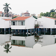 Houses built on stilts stand over the water of West Lake (Ho Tay) in Hanoi, Vietnam.