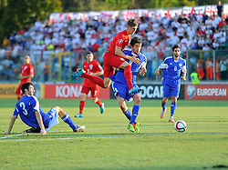 John Stones of England (Everton) battles for the ball with Nicola Chiaruzzi of San Marino (SP Tre Penne)  - Mandatory byline: Joe Meredith/JMP - 07966386802 - 05/09/2015 - FOOTBALL- INTERNATIONAL - San Marino Stadium - Serravalle - San Marino v England - UEFA EURO Qualifers Group Stage