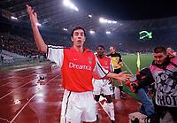 Arsenal goalscorer Robert Pires celebrates his equalizing goal infront of the Arsenal fans. S.S.Lazio 1:1 Arsenal, UEFA Champions League, Group B, Olympic Stadium, Rome, 17/10/2000. Credit Colorsport / Stuart MacFarlane.