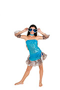 woman in blue dress and large sunglasses on white background