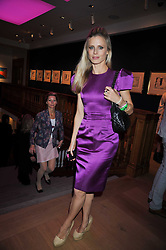 LAURA BAILEY at fundraising dinner and auction in aid of Liver Good Life a charity for people with Hepatitis held at Christies, King Street, London on 16th September 2009.
