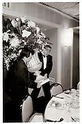 Two men carrying a vase at the Plasa hotel- Annual lunch, Waldart, New York 1988© Copyright Photograph by Dafydd Jones 66 Stockwell Park Rd. London SW9 0DA Tel 020 7733 0108 www.dafjones.com
